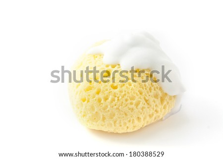 Yellow porous sponge on a white background - stock photo