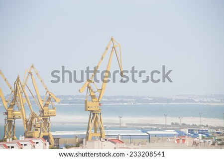 Yellow port crane - stock photo