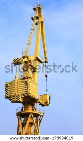 yellow port crane terminal seaport outdoor - stock photo