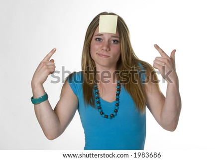 yellow post-it on forehead - stock photo