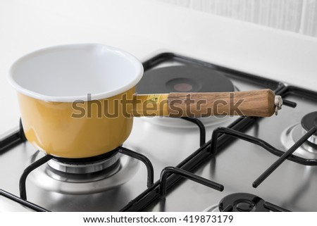 Yellow pot on a gas stove