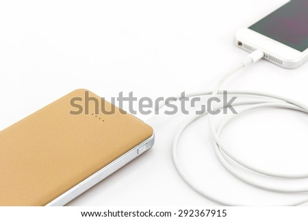 Yellow power bank USB cable for smartphone on white background. - stock photo