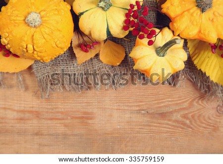 yellow pumpkins on wooden background
