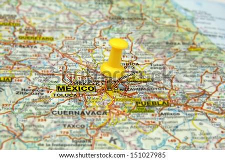 yellow push pin pointing at Mexico City, Mexico - stock photo