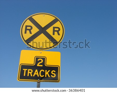 yellow railroad tracks sign - stock photo