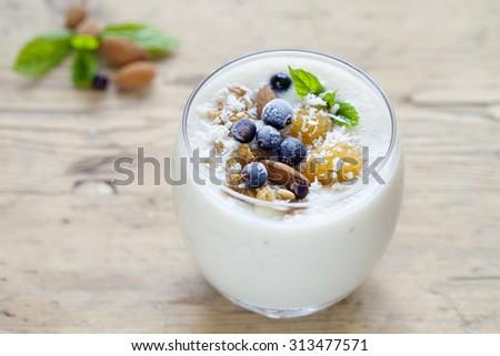 Yellow raspberry, almond, coconut smoothie - stock photo