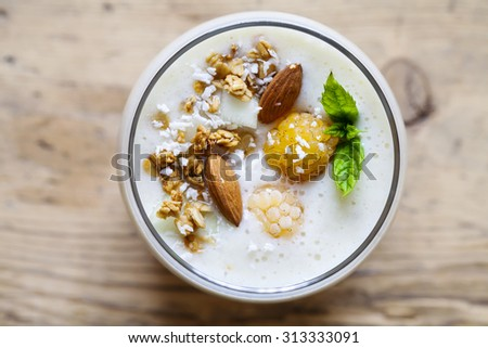 Yellow raspberry, coconut and almond smoothie - stock photo