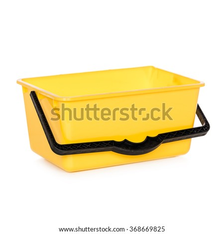 Yellow rectangular plastic bucket isolated white - stock photo