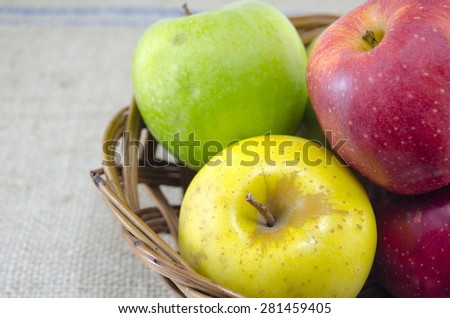 Yellow red and green apples arranged together - stock photo