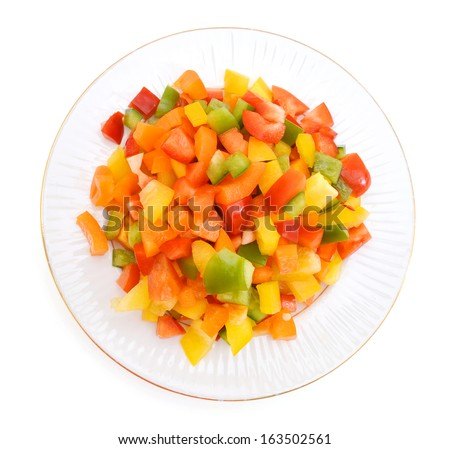 Yellow, red and green peppers Bulgarian. Slicing. Cubes in plate on white  - stock photo