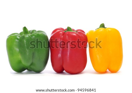yellow, red and green peppers on a white background