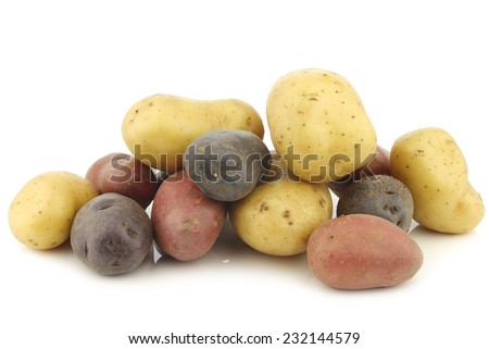yellow, red and purple potatoes on a white background - stock photo