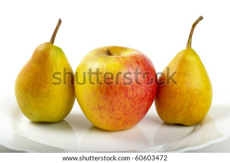 Yellow-red apple and two pears over white plate