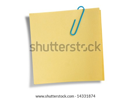 Yellow remainder note isolated on white background, with blue clip. - stock photo