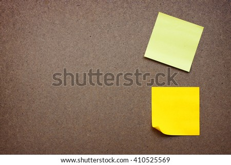 yellow reminder sticky note on wood board.(blank post it note) flat lay.  - stock photo