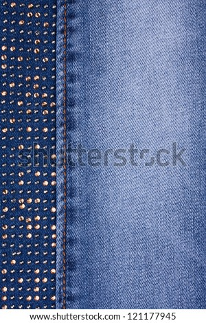 Yellow rhinestones and yellow seam on denim, background, texture - stock photo