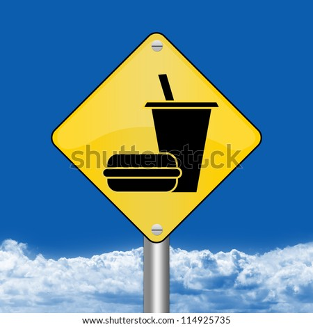 Yellow Rhombus Road Sign For Food and Drink Area Sign Against The Blue Sky Background - stock photo