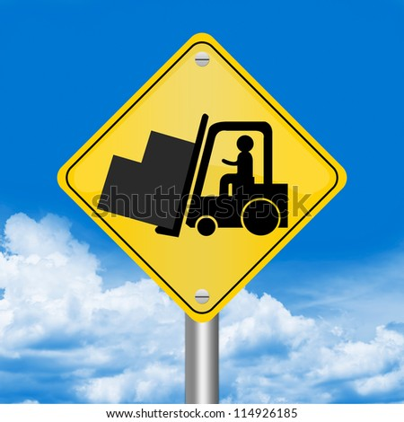 Yellow Rhombus Road Sign For Working Safely Around Forklifts Against The Blue Sky Background - stock photo