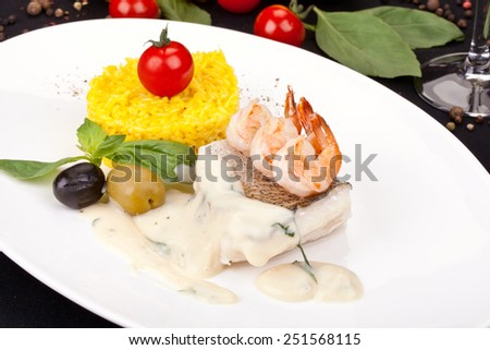 Yellow rice with fish and shrimps - stock photo