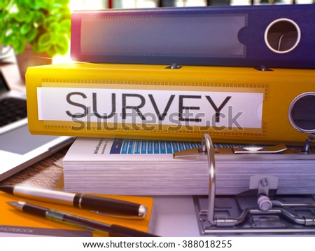 Yellow Ring Binder with Inscription Survey on Background of Working Table with Office Supplies and Laptop. Survey - Toned Illustration. Survey Business Concept on Blurred Background. 3D Render. - stock photo