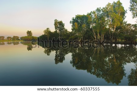 yellow river billabong in the wetland of Kakadu National Park in the Northern territories of Australia south of Darwin - stock photo