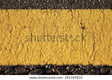 Yellow road mark texture close up - stock photo
