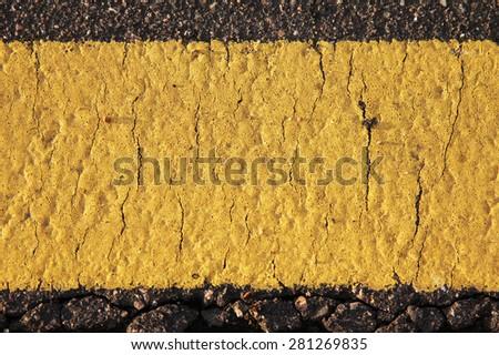 Yellow road mark texture close up - stock photo
