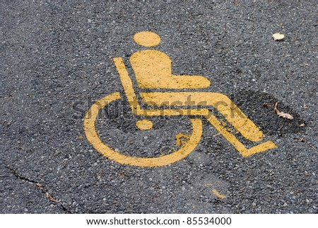 yellow road marking for disabled and invalid parking
