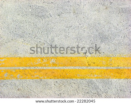Yellow road marking lines pictured from above - stock photo