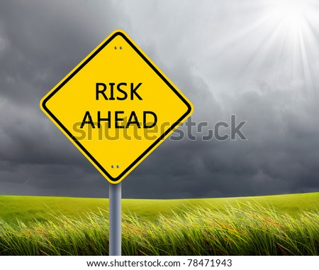 yellow road sign as a warning of risk ahead - stock photo