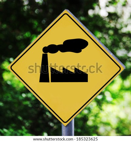 Yellow road sign outdoor with factory pictogram - stock photo