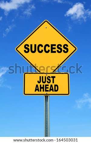 Yellow road sign success just ahead - stock photo