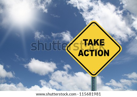 Yellow road sign Take Action - stock photo