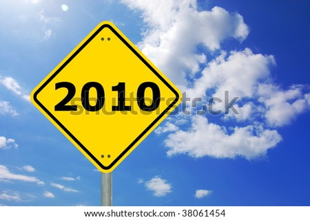 yellow road sign with year 2010 and blue sky