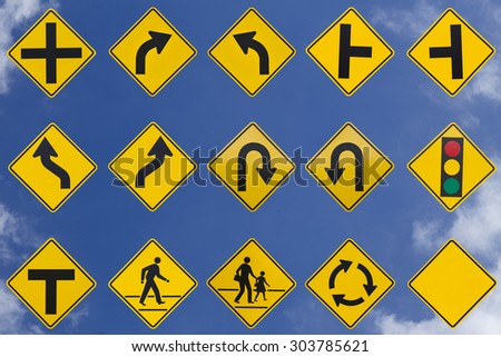 yellow road signs, traffic signs set on sky background - stock photo
