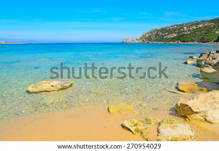 yellow rocks in Capo Testa shoreline, Sardinia - stock photo