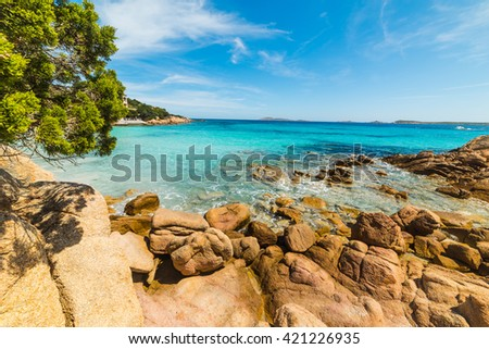 yellow rocks in Capriccioli beach, Sardinia - stock photo