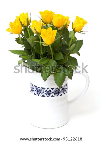 yellow roses in a vase isolated on white