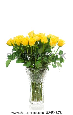 Yellow roses in the vase isolated on white background - stock photo