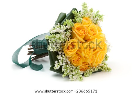 Yellow Roses wedding bouquet lying down on a white background. - stock photo