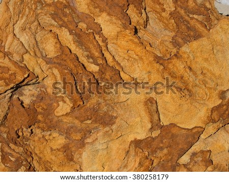 Yellow rough stone texture close up horizontal background