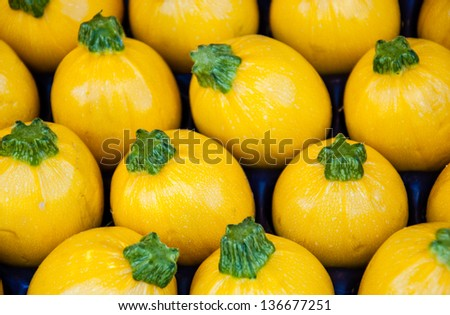 Yellow round  zucchini  at farmers market in Paris. - stock photo