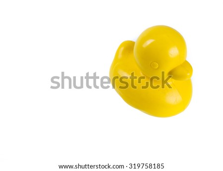 yellow rubber duck isolated on white - stock photo
