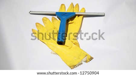 yellow rubber gloves and window squeegie on white, representing the cleaning service industry and other concepts - stock photo