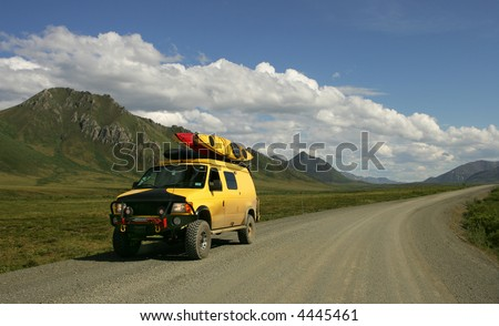 Yellow RV on Dempster Highway above Arctic Circle, Canada