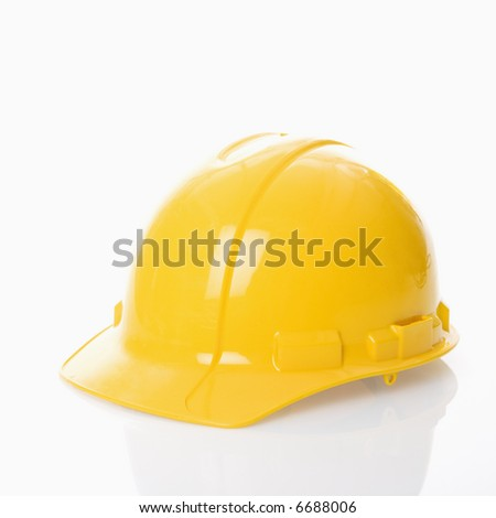 Yellow safety hard hat. - stock photo