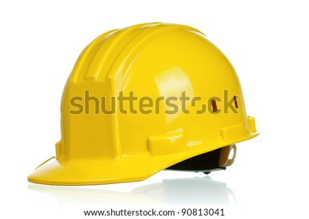 Yellow safety hard hat on white background - stock photo