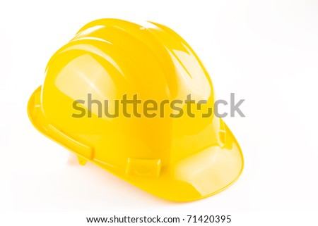 Yellow safety hat isolated over white background - stock photo