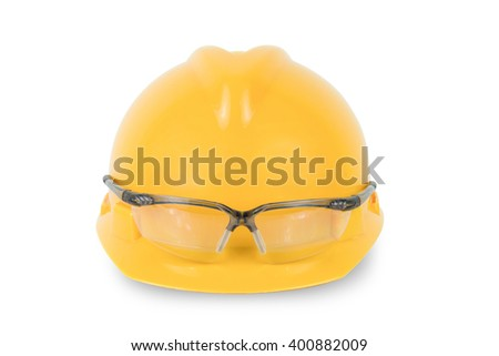 Yellow safety helmet and goggles  isolated on white background - stock photo