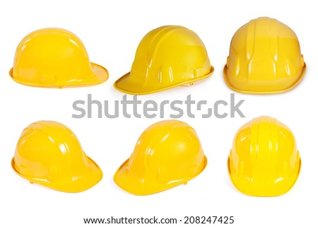 Yellow safety helmet collection on white background - stock photo
